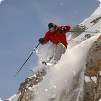 Skier jumping off cliff